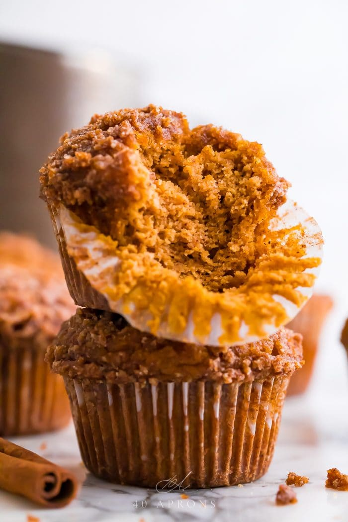 Half of a healthy pumpkin muffin stacked on top of another