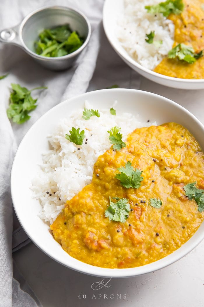 Indian Dal garnished with fresh herbs and served with rice