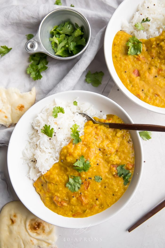 Two bowls of instant pot dal served with rice