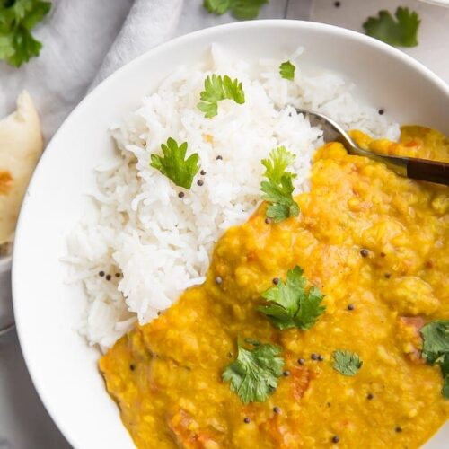 Instant Pot dal over basmati rice in a white bowl