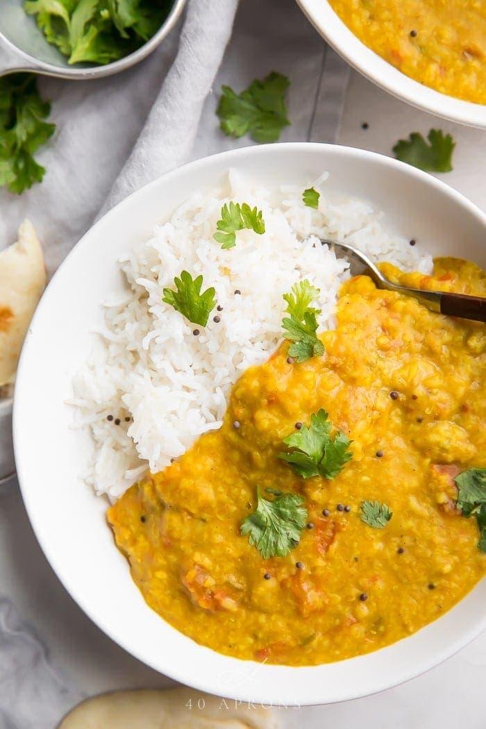 Instant Pot dal over basmati rice in a white bowl