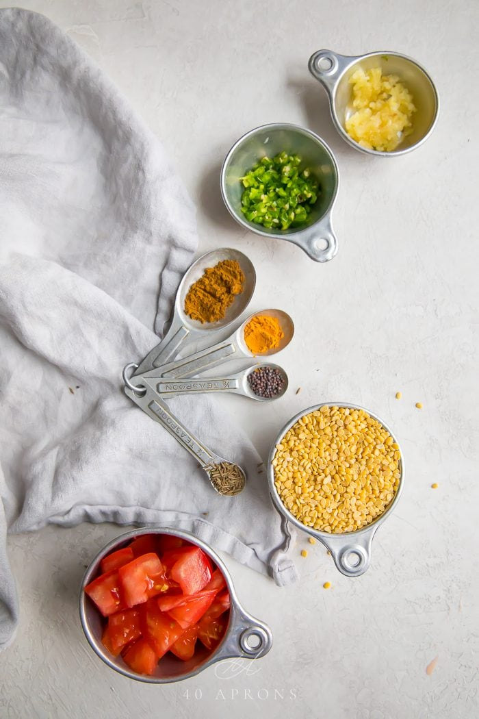 Ingredients to make the dish on a white work surface