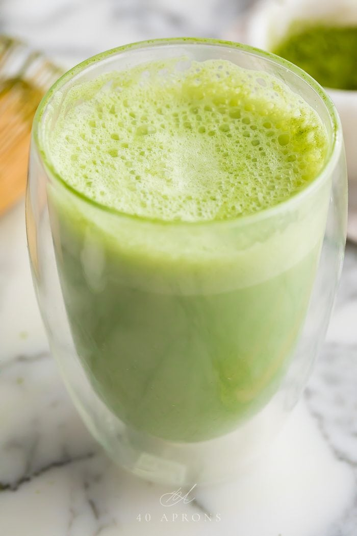 A matcha latte served in a glass mug
