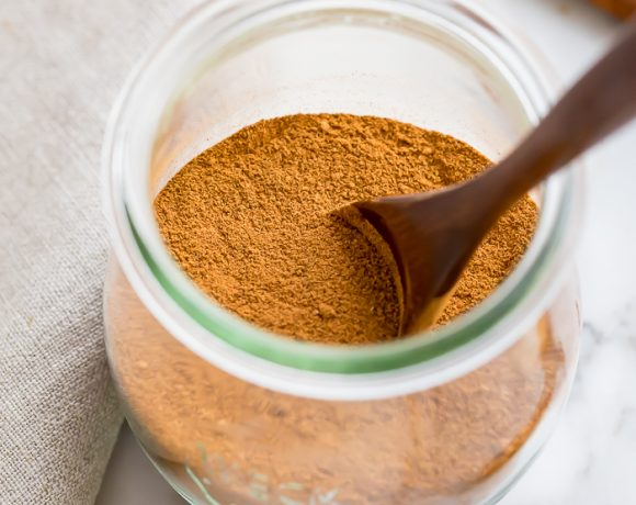 Spice blend in a glass jar on a work surface