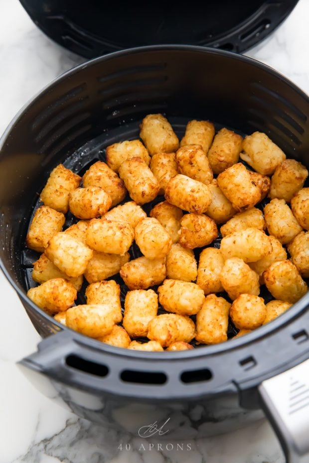 Cooked tater tots in an air fryer