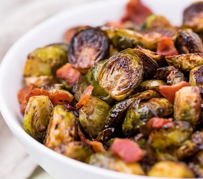 Balsamic Brussels sprouts and bacon in a white dish