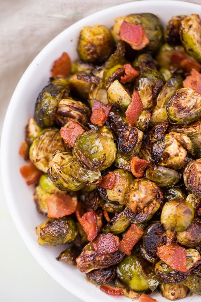 Sprouts and bacon in a serving dish