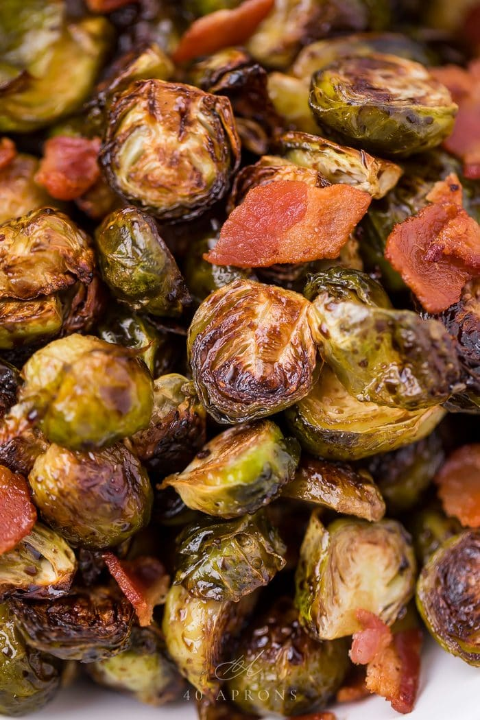 Close up of balsamic Brussels sprouts served with bacon