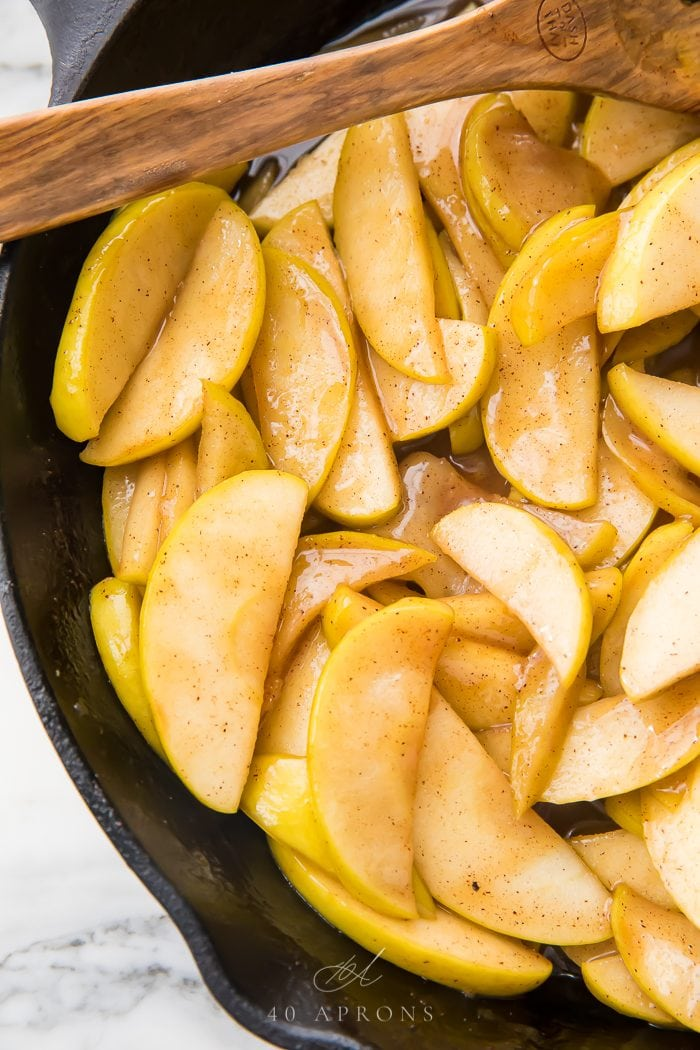 Apples cooking in a skillet