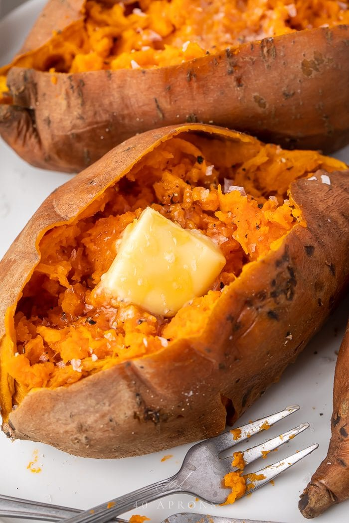 An instant pot sweet potato served with butter