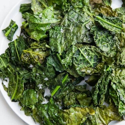 Crispy kale chips served on a plate