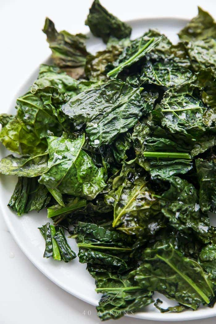 A pile of crispy kale chips on a plate