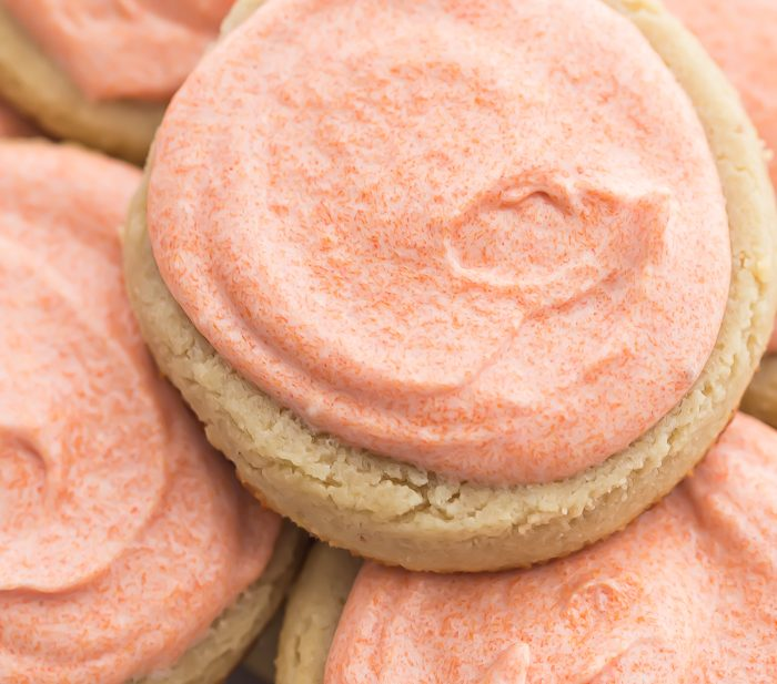 Pink iced cookies stacked on top of eachother