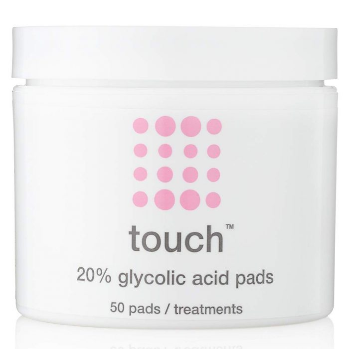 a container with glycolic acid exfoliation pads for acne plagued skin against white background