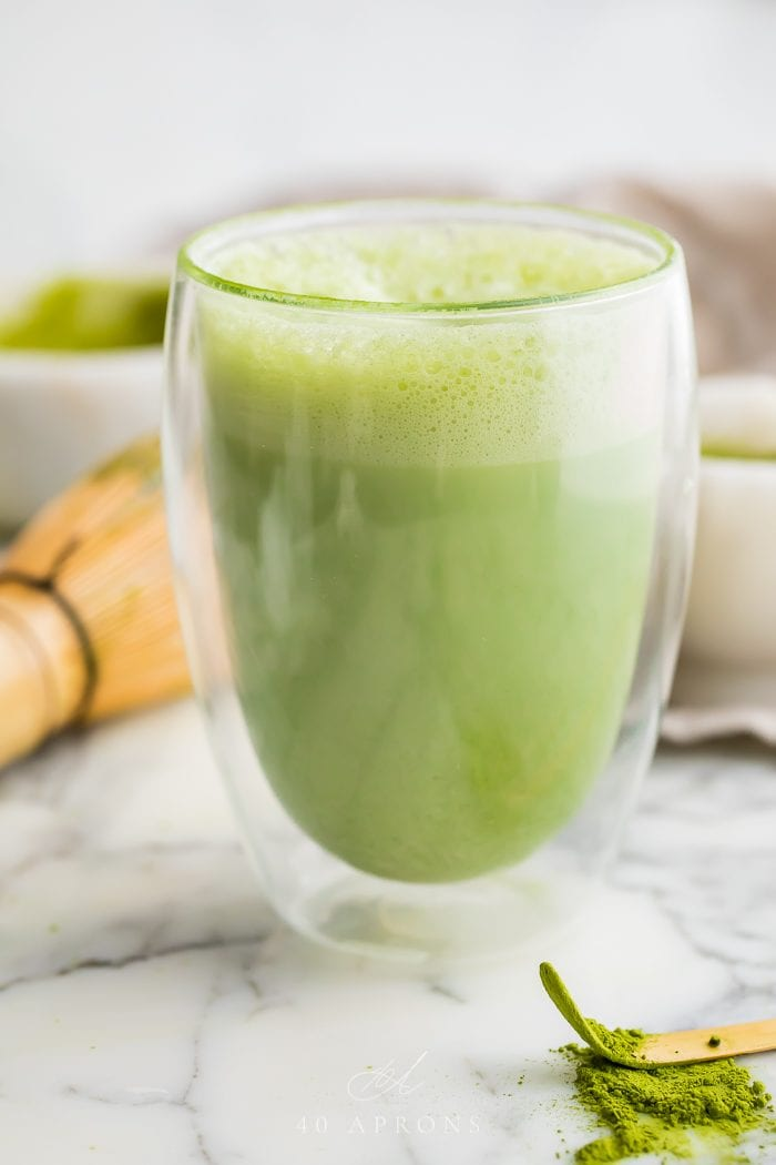Matcha latte in a double walled glass