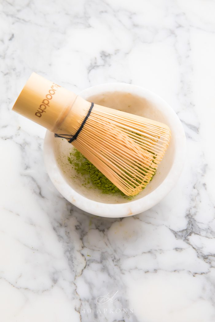Bamboo whisk in bowl of matcha