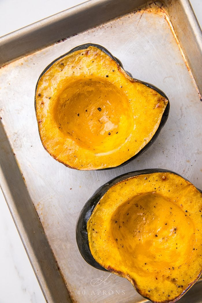 Two roasted halves of acorn squash
