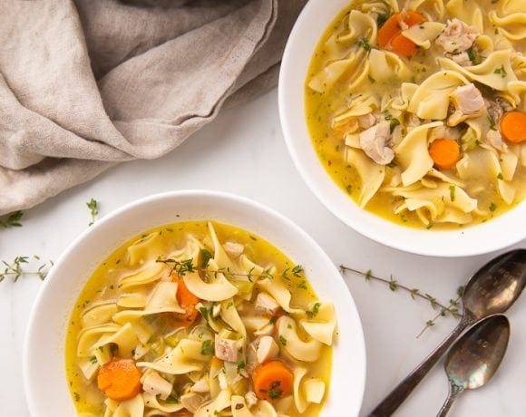 Two bowls of leftover turkey soup