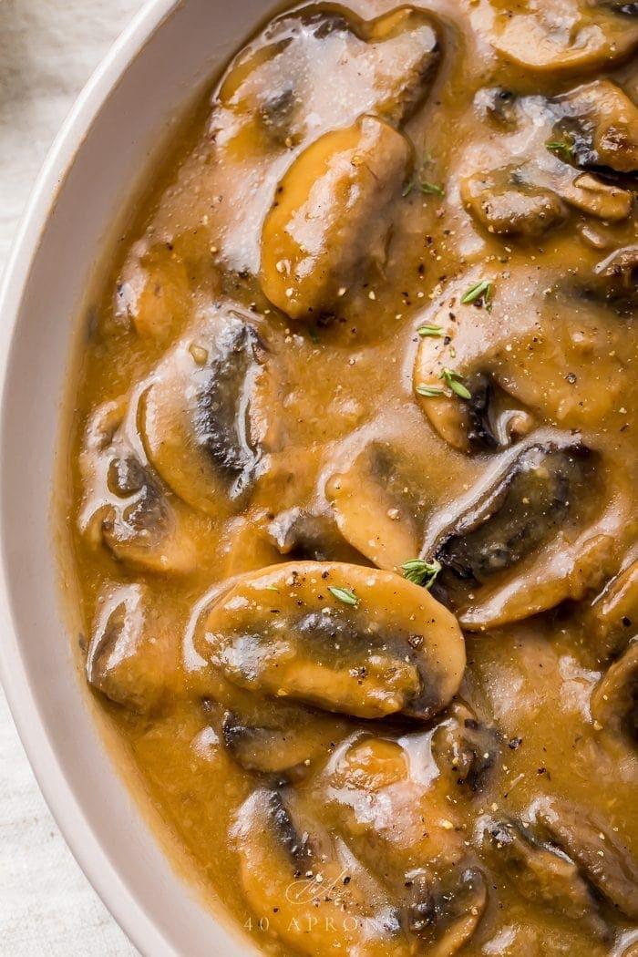 Mushroom gravy in a white bowl