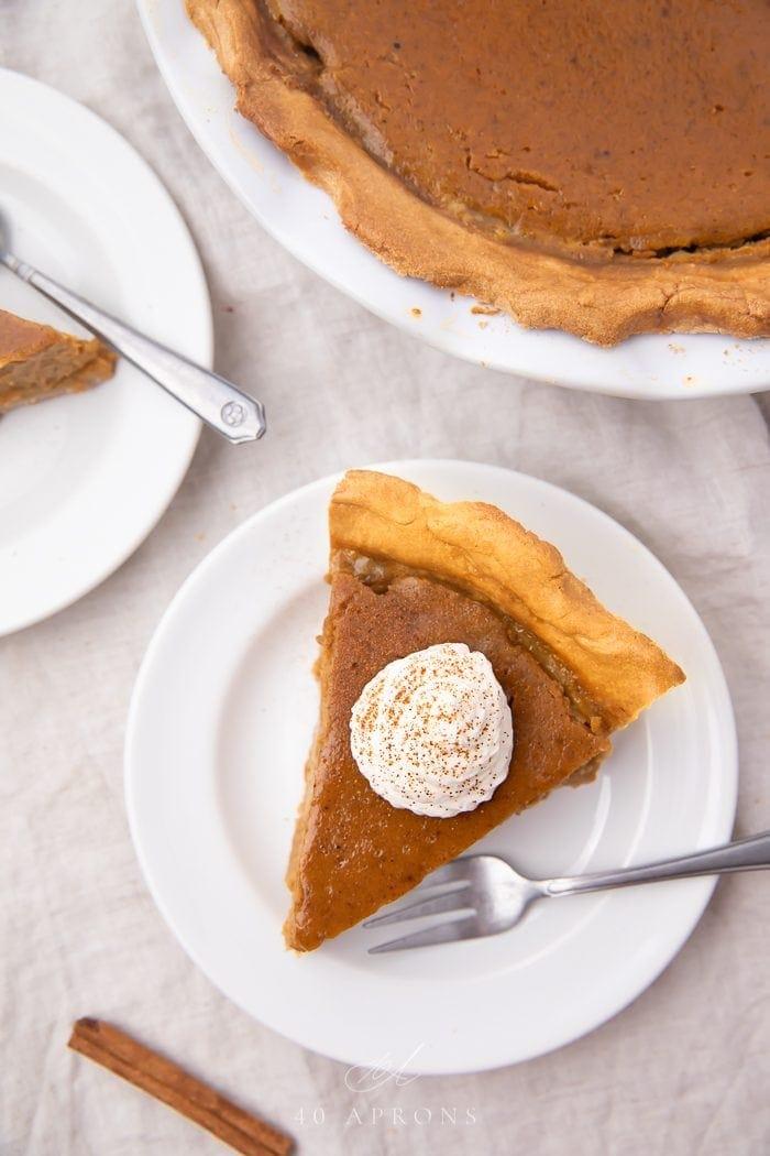 A slice of paleo pumpkin pie on a white plate