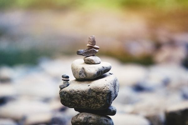 a pile of different sized stones and pebbles stacked on top of each other in a zen garden