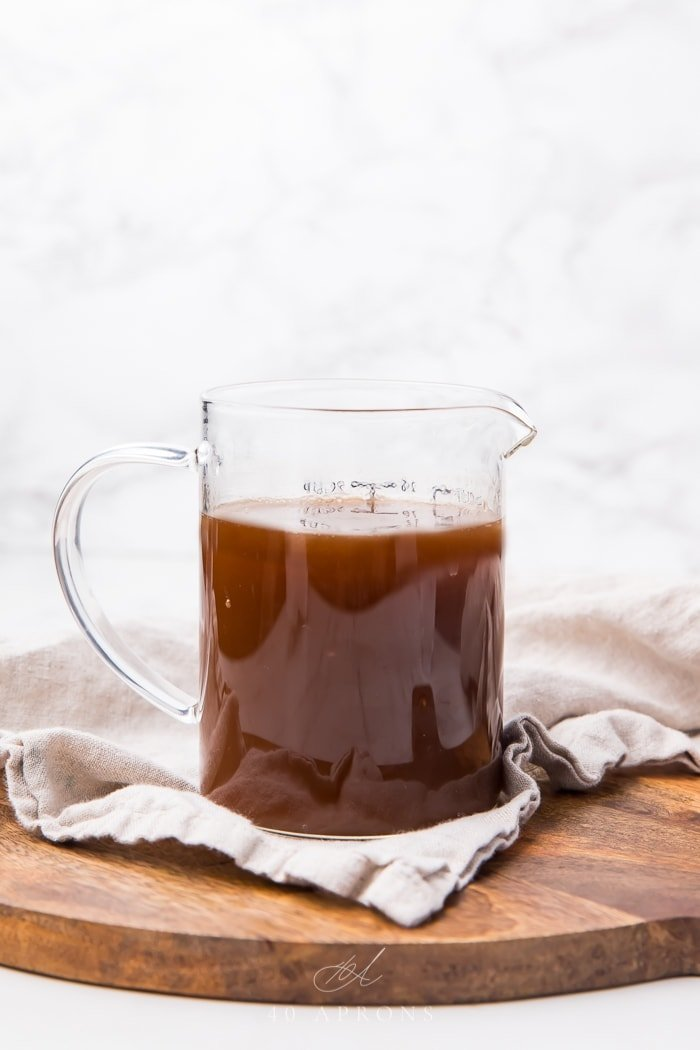 Au jus in a glass jug