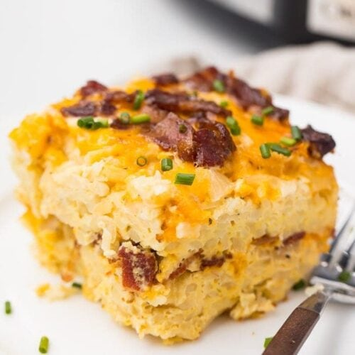 Crockpot breakfast casserole on a plate in front of slow cooker