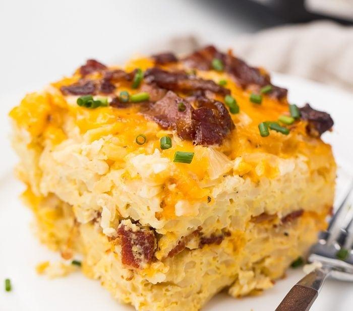 Crockpot breakfast casserole on a plate in front of slow cooker