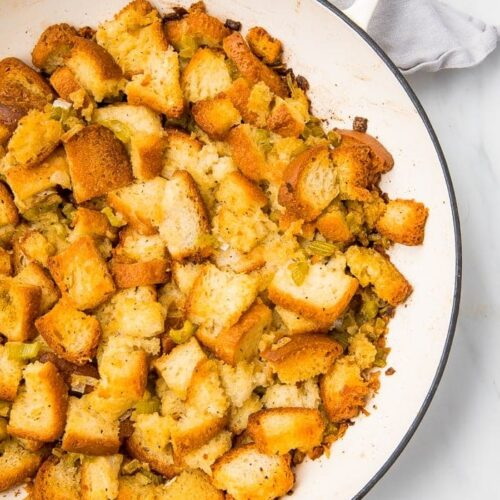 Gluten free bred stuffing on a white plate