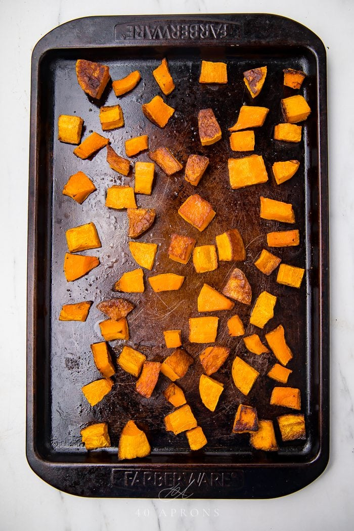 Top shot of cubed butternut squash after being cooked in the oven