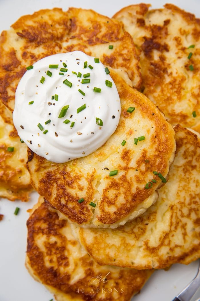 Sour cream on top of the savory pancakes