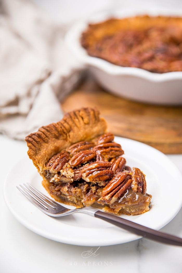 Pecan pie served on a plate with a fork