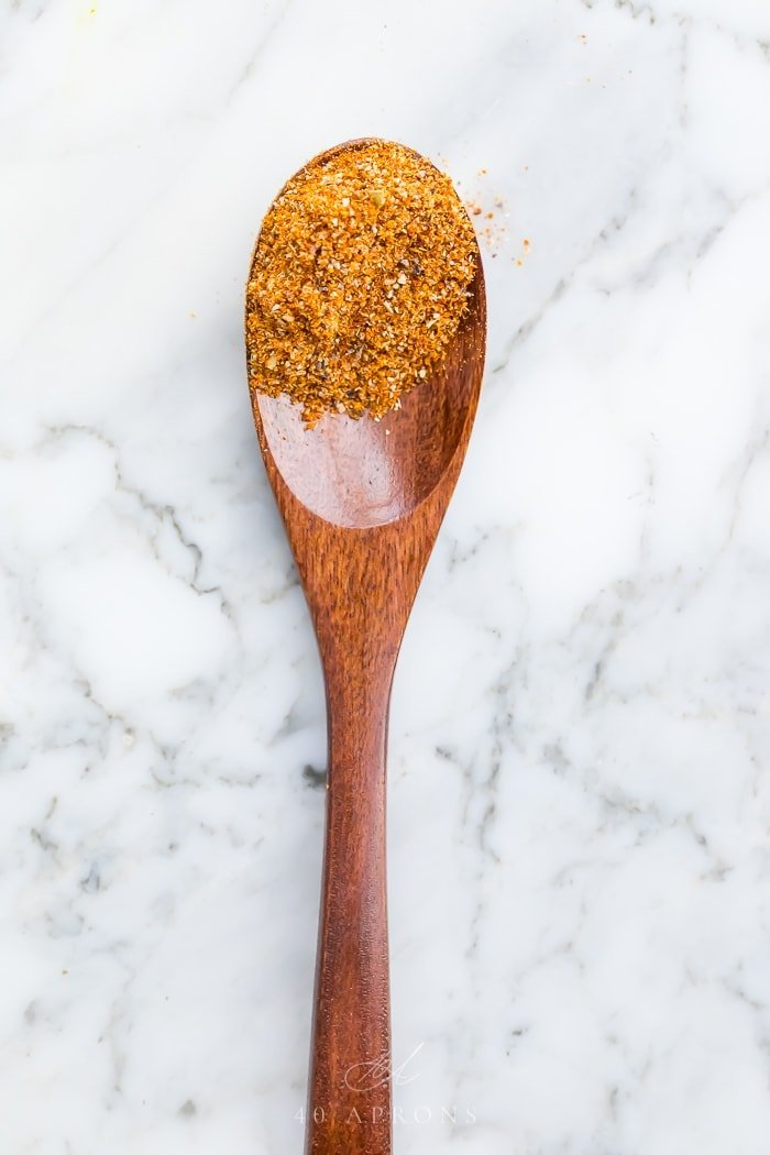 Spice mix on a wooden spoon