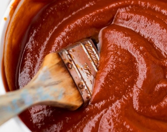 A bowl of the whole30 bbq sauce with a brush in it