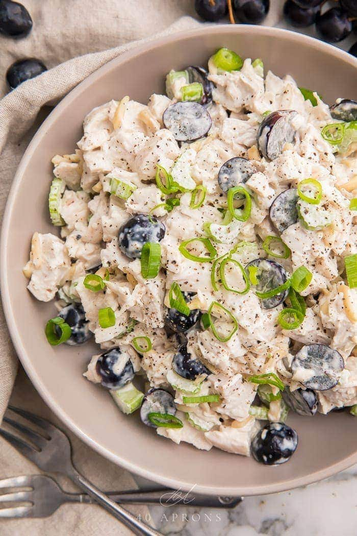 Whole30 chicken salad in a grey bowl with grapes