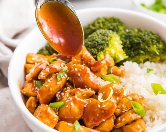 Spooning sauce over the teriyaki chicken