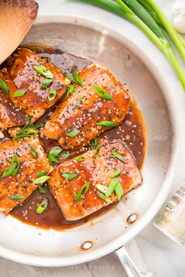 Fillets of salmon in teriyaki sauce in a white bowl