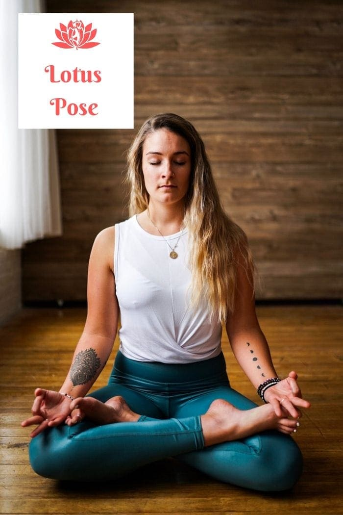 a blonde long-haired woman sitting on the floor in the lotus position