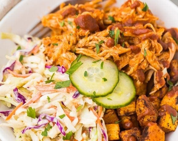BBQ chicken bowl with sweet potatoes and coleslaw in a bowl