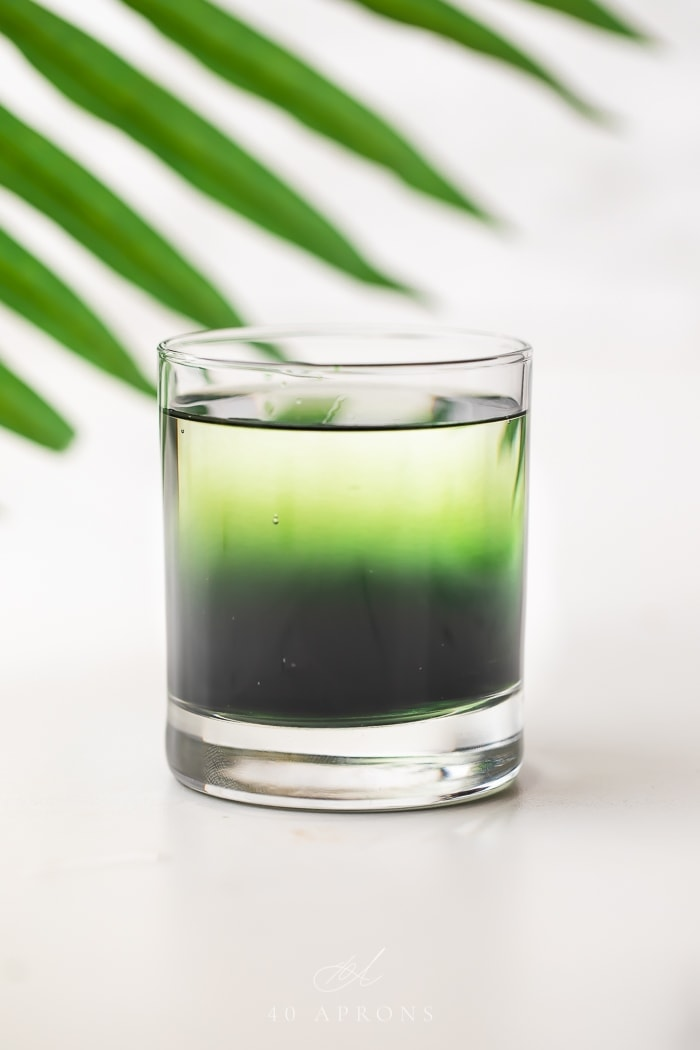 Green chlorophyll water in a glass
