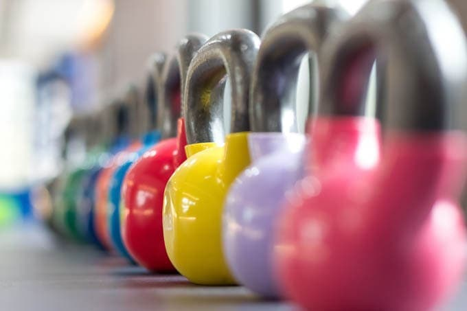 colorful row of kettlebells