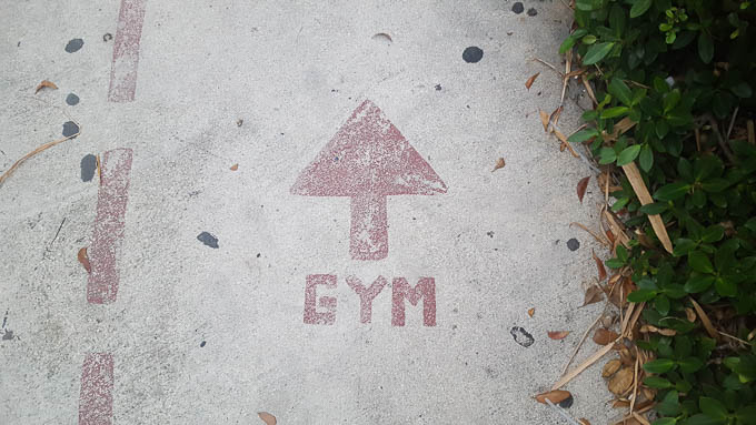 image of gym painted on concrete with arrow