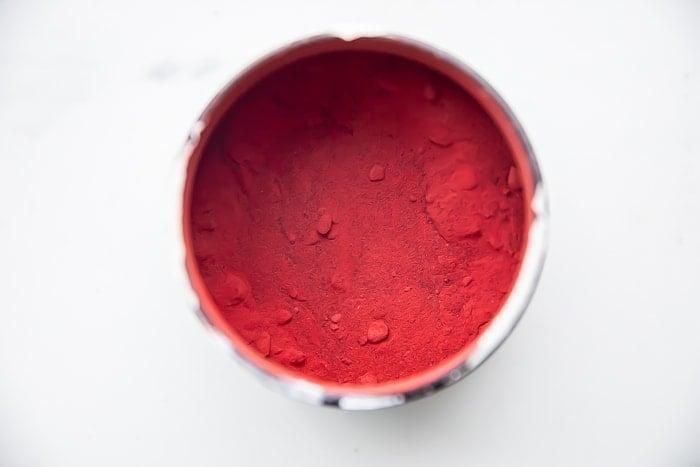 Beet powder in a white mug