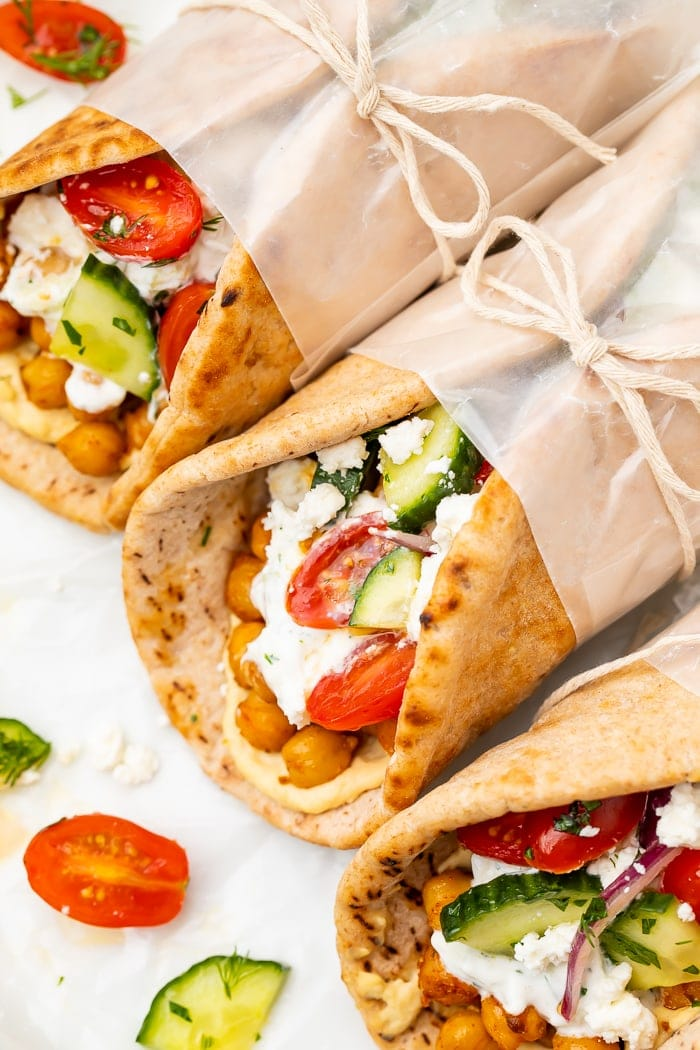 Gyros wrapped in wax paper and tied with string