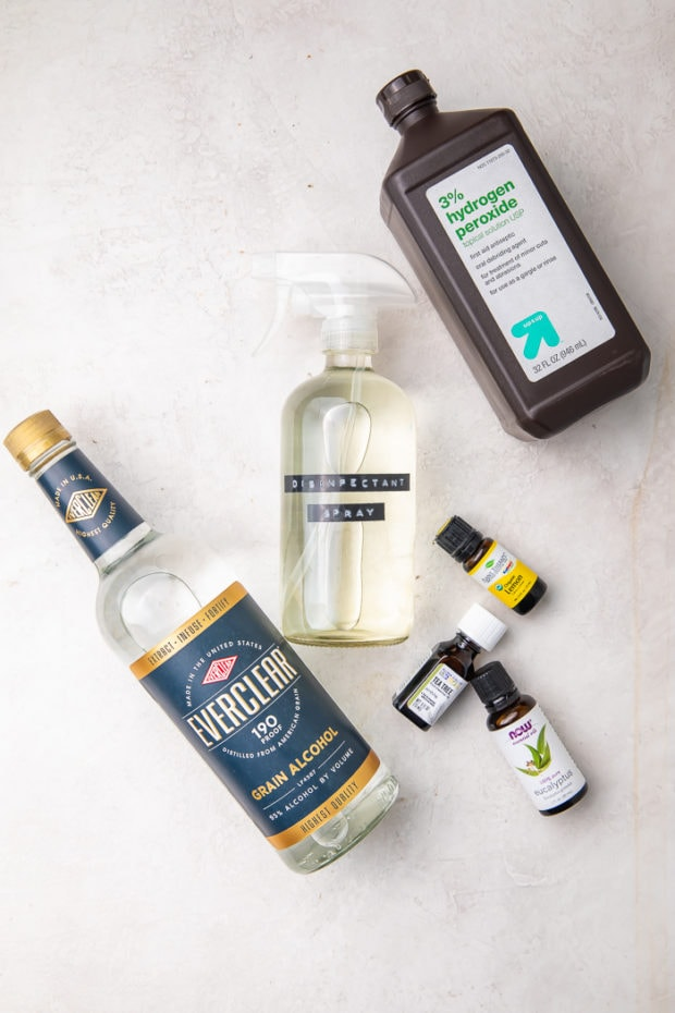 Ingredients for DIY disinfectant (Lysol spray) on a white board