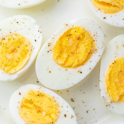 Air fryer hard boiled eggs on a white plate