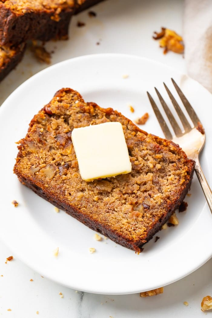 Slice of banana bread with a pat of butter
