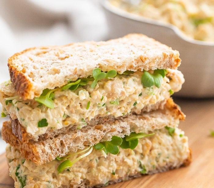 Chickpea salad sandwich on a wooden board