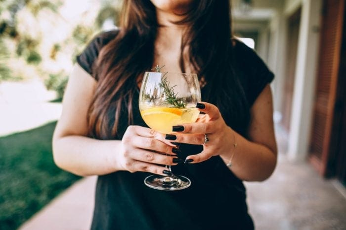 Woman holding a large cocktail