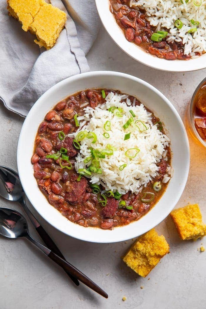 Instant Pot red beans and rice in a bowl with a side of cornbread